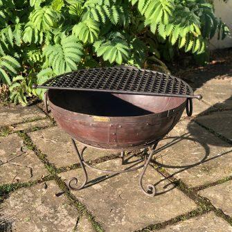 Kadai 60 & BBQ Rack in garden