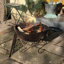 Kadai 60 & BBQ Rack lit in garden