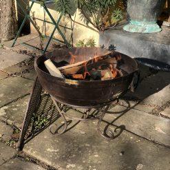Kadai 70 & BBQ Rack lit in garden