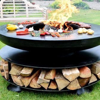 Ring of Logs with BBQ Ring lit in garden