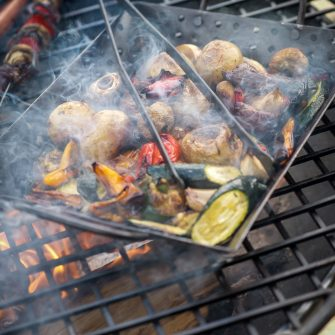 Tongs and Vegetable Tray over Fire Pit