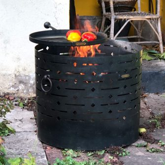 Diamond fire pit with swing arm cooking