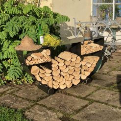 Half Circular Log Store in garden with logs