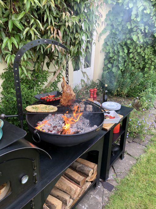 Hanging Arm with Hook cooking meat over fire pit