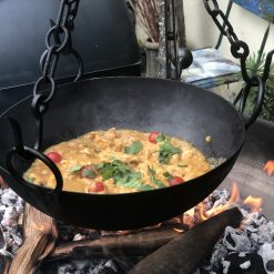 Close up of food in hanging cooking bowl