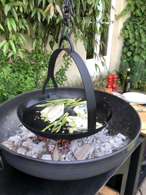 Flat Bottomed Hanging Skillet Pan over fire pit cooking food