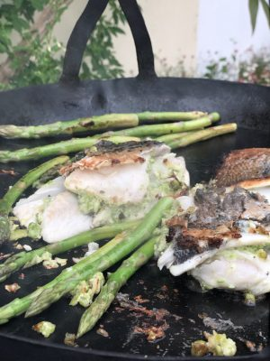 Close up of food cooking on Flat Bottomed Hanging Skillet Pan