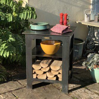 Modular Kitchen work station in garden with log store