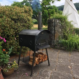 Traditional Pizza Oven with wigwam in background