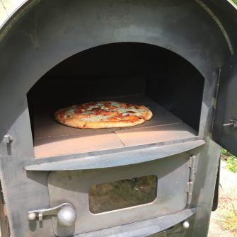 Modular Kitchen Tall Pizza Oven close up of door open with pizza in oven