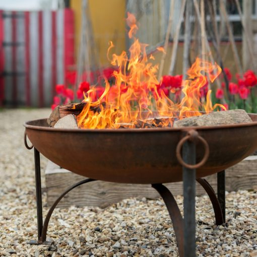 Plain Jane Fire Pit Lifestyle Rusted - Close Up with Tulips - FirepitsUK - WEB - Lo Res
