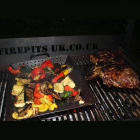 Asado BBQ with Log Store Lit Close up of Food Lifestyle - Firepits UK - BBQ - Lo Res