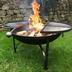 BBQ King 80 Fire Pit with 2 Swing Arm BBQ Racks Lit Side On Lifestyle - Firepits UK - WEB - Lo Res