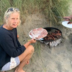 Beach BBQ Fire Pit Lit with Burgers and Sausages Lifestyle - Firepits UK - WEB - Lo Res