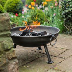 Celeste Fire Pit Lifestyle lit in garden - FirepitsUK - WEB - Lo Res