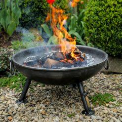 Celeste Fire Pit Lifestyle lit in garden -Tulips - FirepitsUK - WEB - Lo Res