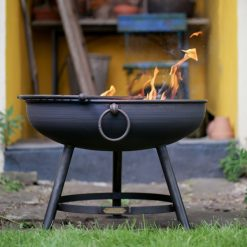 Classic Fire Pit Lit in front of Tool Shed with Half Moon BBQ Rack Lifestyle - Firepits UK - WEB - Lo Res
