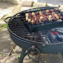 Classic Fire Pit Lit with Half Moon BBQ Rack and Kebab Rack Lifestyle - Firepits UK - WEB - Lo Res