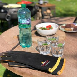 Fire Pit Gloves on Outdoor Table Lifestyle - Firepits UK - WEB - Lo Res