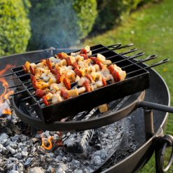 Kebab Rack on Lit Fire Pit with Chorizo and Chicken on Swing Arm BBQ Rack Lifestyle - Firepits UK - WEB - Lo Res