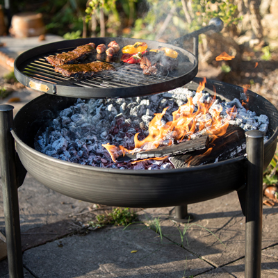 Legs Eleven Fire Pit Lit with Swing Arm BBQ Rack Lifestyle from Above - Firepits UK - WEB - Lo Res.
