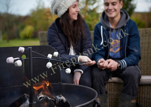 Marshmallow Fork for Fire Pit with Marshmallows and Couple over Lit Fire Pit Lifestyle - Firepits UK - WEB - Lo Res