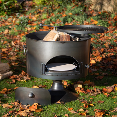 Pete's Oven 70 Fire Pit with Swing Arm BBQ Rack and Pizza Stone Lifestyle - Firepits UK - WEB - Lo Res