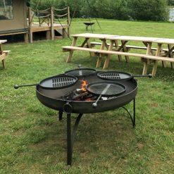 Plain Jane 120 with 4 Swing Arm BBQ Racks Lit Lifestyle - Firepits UK - WEB - Lo Res