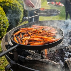 Plain Jane 90 with 3 Swing Arm BBQ Racks Fire Pit close up of carrots Lifestyle - Firepits UK - WEB - Lo Res