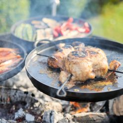 Plain Jane 90 with 3 Swing Arm BBQ Racks Fire Pit close up of chicken Lifestyle - Firepits UK - WEB - Lo Res