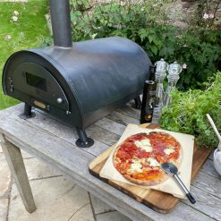 Table Top Pizza Oven Fire Pit with cooked pizza Lifestyle - Firepits UK - WEB - Lo Res1