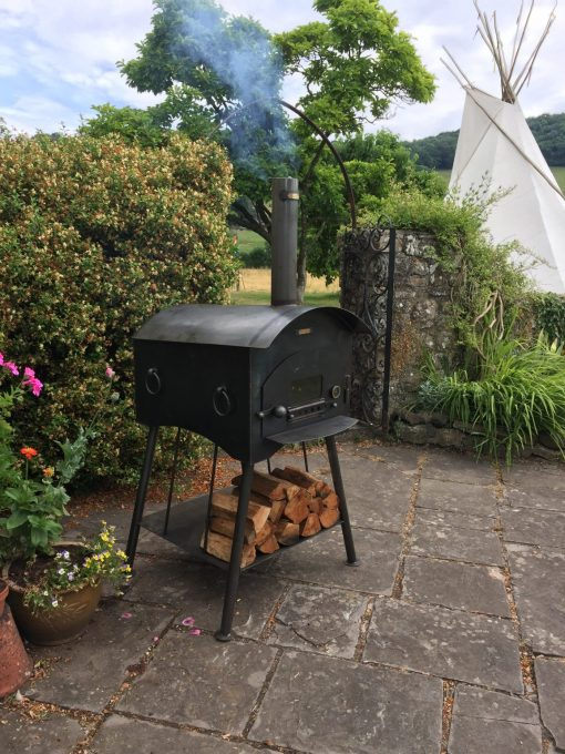 Traditional Pizza Oven Fire Pit Lit with Logs Lifestyle - Firepits UK - WEB - Lo Res