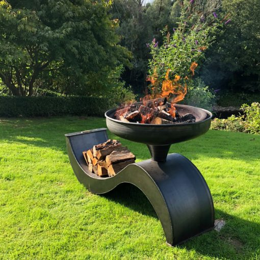 The Wave 70 Fire Pit Lit with Logs Side Angle Lifestyle - FirepitsUK - WEB - Lo Res