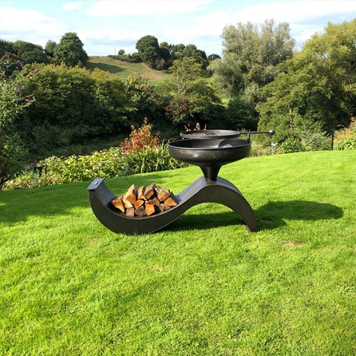 The Wave 70 Fire Pit with Swing Arm BBQ Rack with Logs Lifestyle - FirepitsUK - WEB - Lo Res