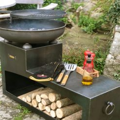 Tiered Fire Bowl 60 with Log Store Fire Pit Side view Lifestyle - Firepits UK - WEB - Lo Res