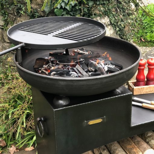 Tiered Fire Bowl 60 with Swing Arm BBQ Rack and Log Store Lit Fire Pit Lifestyle Close Up - Firepits UK - WEB - Lo Res