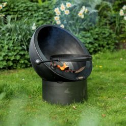 Tilted Sphere Fire Pit Lit with Swing Arm BBQ Rack Lifestyle - Firepits UK - WEB - Lo Res