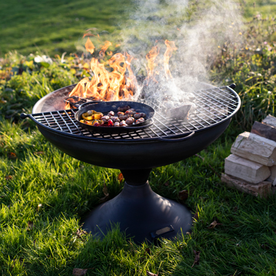 Wine Glass Fire Pit Lit with Half Moon BBQ Rack and Skillet Pan with Peppers and Pigs in Blankets from Afar Lifestyle - Firepits UK - WEB - Lo Res